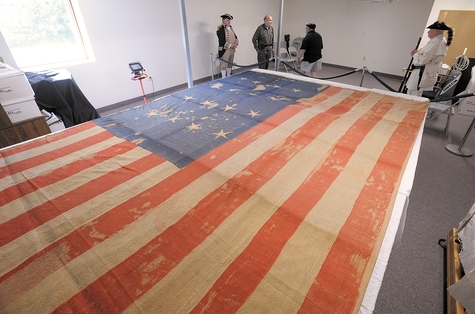 The Stonington Historical Society is the caretaker of the Stonington Battle Flag, shown above during its last public viewing in 2009. The flag was flown by the defenders of Stonington in 1814 while the village was under attack by the British. It will be on display as part of an exhibit at the Lyman Allyn Art Museum in New London starting July 6.